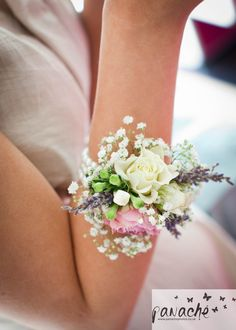 This wrist corsage was created on ivory ribbon with lavender, gypsophila and spray roses