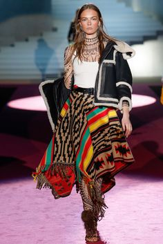 Dsquared² Fall 2015 Ready-to-Wear -  Maori inspired Tatoo turtleneck and leggings, Native American poncho skirt with fringe.   Sheepskin aviator styled jacket.  Fur sandals