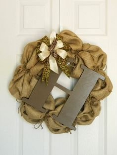 Burlap Wreath with Letter and Bow. $115.00, via Etsy.