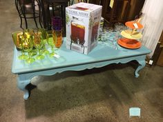 "This cocktail table has been painted in a light turquoise, distresses and then white waxed.  This is a really popular color right now.  This will give your room that pop of color it needs!  Dimension:  56"" x 23"" x 16"""