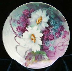 Daisies and berries painted on porcelain tile by porcelain artist and teacher, Gerry Burchill of New York's Adirondack region