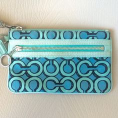 """Coach Wristlet Turquoise wristlet with signature coach logo pattern.  Approximately 8"""" x 5"""" Coach Bags Clutches & Wristlets"""