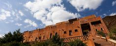 Abyaneh Village with a magnificent scenery and mild climate is famous for its crimson red clay architecture. Visit Iran, Historical Monuments, Cultural Events, Village Houses, Brick And Stone, Old Houses, Tourism, Scenery, Old Things