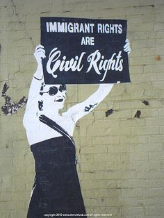 Detroit street art: Immigrant Rights are Civil Rights. I'd say Human Rights. Voluntaryists are for open immigration.