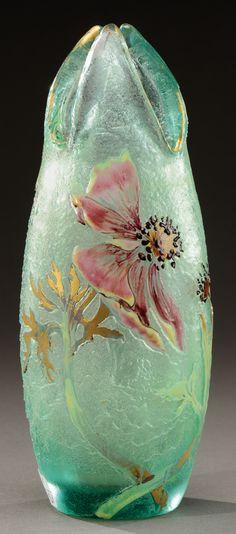 EMILE GALLÉ A lined glass vase acid-etched and enamelled open anemones. Signed by hand in enamel «Cristallerie d'Emile Gallé Nancy-modèle et décor déposé». Circa 1890-1900. H : 8 ¾ in