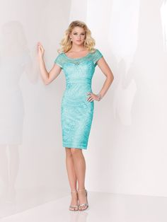 Social Occasions by Mon Cheri - 115869 - Soutache on tulle knee-length sheath with illusion cap sleeves, illusion wide scooped neckline over sweetheart bodice with illusion V-back, soutache empire waistband, center back slit, suitable as a dress to wear to a wedding. As shown in Turquoise: Jeweled Occasions bracelet style Beverly sold separately. As shown in Champagne: Jeweled Occasions necklace and drop earring style Dallas sold separately.Sizes: 4 – 20Colors: Turquoise, Champagne