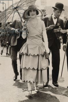 1920's Dress with gathering at the hips and three long tiers of fabric on the skirt.