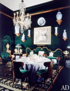 Alberto Pinto. What's more chic than a green velvet dining room?