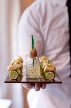 The Mini Fish Taco paired with Margaritas in mini Patron bottles.  Stylish conversation starters…