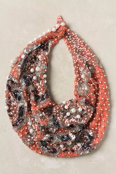 What if you took apart an old beaded dress to create this look?  Coralline Scarf Necklace - Anthropologie.com