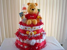 This Pooh Diaper Cake includes: 60 Pampers Swaddlers size 1 Travel size baby lotion, shampoo, powder, head-to-toe wash, Desitin, and soothing lotion. 1 pacifier & clip 1 comb & brush set 1 medicine dropper 1 nose aspirator 1 rec. blanket 2 bottles 1 travel size pack of wipes