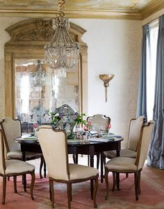 Great oversized mirror in this New Orleans Dining Room