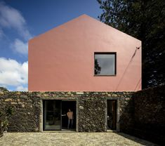 Mezzo Atelier transforms century-old barn into bright pink guesthouses