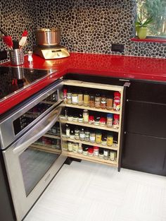 Red countertops with river rock backsplash (but I'd do it w/ stainless stell backsplash)