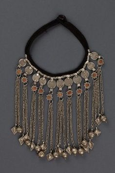 Yemen | Necklace; silver and coral.  Consists of 8 pendants, each hanging from an Islamic silver coin | ca. early 1900s | 650€