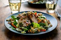 Spicy Thai Pork Tenderloin Salad by NYT Cooking: Lean pork tenderloin is marinated with chiles, ginger root and cilantro, grilled or broiled, then combined with cabbage, fresh herbs and nuts and coconut for richness. A bit of reserved marinade serves as the dressing.  #Salad #Pork_Tenderloin #Thai