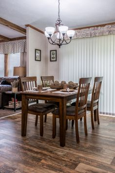 Commodore Homes of Pennsylvania Astro Ranch -  - 3A255A | Eat-in Kitchen Nook with Vinyl Sliding Patio door