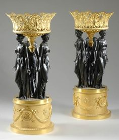Pair of Empire Style Gilt and Patinated-Bronze Figural Baskets   Each circular reticulated top cast with scrolling vines and grape clusters, on triple female supports, each clad in a long flowing robe, on a round pedestal base. Height 35 inches (89 cm), diameter 15 1/2 inches (39 cm).