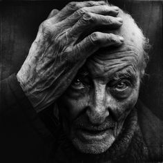by Lee Jeffries, old man, powerful face, hand, fingers, wrinckles, aged, lines of Life, beard, intense eyes, portrait, photo b/w