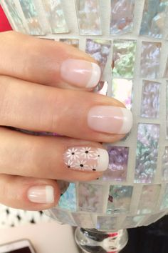 Pretty french manicure with flowers. #pronails #calgel