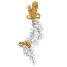Gold, Platinum and Diamond Cascade Bow Brooch, France  18 kt., topped by a textured gold bow supporting two white gold herringbone chains surmounted by a cascade of florets set with 28 round and 57 marquise-shaped diamonds approximately 9.50 cts., cinched with a smaller textured gold bow,