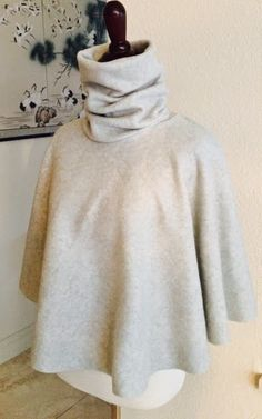 Sewing tutorials are such a great way to get high-end looks without the hefty price tag. This 15 Minute Turtleneck Cape Tutorial is a luxurious piece of DIY clothing that will keep you extra-cozy in the cold winter months. Cape Tutorial, Diy Tutorial, Photo Tutorial, Sewing Patterns Free, Sewing Tutorials, Sewing Projects, Free Sewing, Sewing Tips, Poncho Pattern Sewing