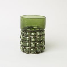 Green Dimpled Glass Candle Holder: Dimpled Glass Candle Holder in heavy olive green glass with a raised dimpled oval and strap detailing. Retro in style, ideal for tea-lights or small pillar candles.