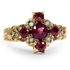The Aminlai Ring, 1870's This charming Victorian ring features five extraordinary garnets and four seed pearl accents in a romantic halo setting (Garnet approx. 1.02 total carat weight).