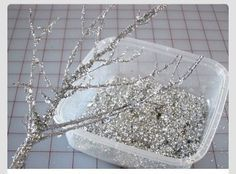 Spray glue on branches and add glitter for inexpensive holiday decoration