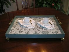 Make a decorative serving tray from a thrift shop picture frame and a pair of drawer or cabinet pulls.