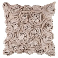Pillow with a textured rosette design.   Product: PillowConstruction Material: Cotton, linen and rayon cover
