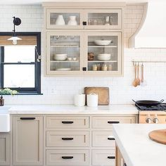 Happy Tuesday! At least it's not Monday anymore . . I am loving this kitchen by @prairie_home_styling ....the cabinet color is perfect with the black hardware and subway tile. I also love how the cabinets don't have backs to them simplistic drama! Photo: @ryangarvin . . What do you love in this kitchen?? . . . #interior4you #whiteinterior #hgtv #fixerupperstyle #fixerupper #homestyle #bhghome #pursuewhatislovely #theeverygirl #nothingisordinary #mydecorhaven #whitespaceswelove #mydecorvibe…