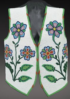 Plateau beaded vest c. early 1900's; fancy man's vest, front panels are completely beaded with beautiful florlas.