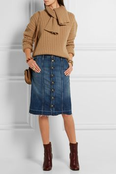 J.W. Anderson (sweater). Current/Elliott (skirt). Chloé (bag). Marni (boots).