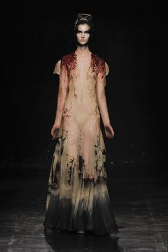 Julien Fournié Haute Couture Fall 2010. Inspired by martyrdom, Julien Fournié elicited beauty from darkness and sadness usually associated with the suffering of death on account of adherence to a cause, especially to one's religious faith.