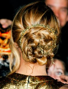 """Jennifer Lawrence at """"The Hunger Games"""" L.A. premiere - Hairstylist Mark Townsend wove three Jennifer Behr headbands into Lawrence's bun to create this style."""