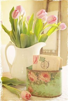 simply love tulips! in a white pitcher shows them off perfectly. the tin of letters is an added touch of romance
