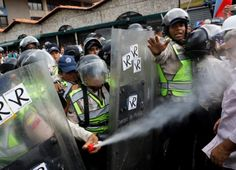 Protesting pensioners throw punches in latest Venezuela unrest | Reuters