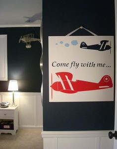 boys airplane room. love the navy with white wainscotting underneath with red accents!