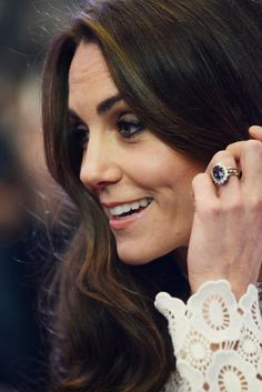 Celebrity Gossip & News   Kate Middleton Pets a Cat and Plays With a Baby During Her Solo Night in London   POPSUGAR Celebrity Australia