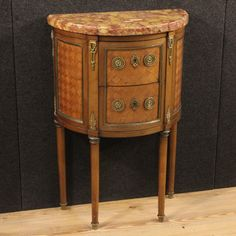 1250€ Small French inlaid demi lune commode with marble top. Visit our website www.parino.it #antiques #antiquariato #furniture #inlay #antiquities #antiquario #comò #commode #dresser #chest #drawer #golden #gold #decorative #interiordesign #homedecoration #antiqueshop #antiquestore