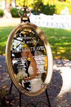 Gold oval mirrored wedding program