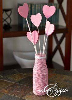 Quick and easy Valentine Centerpiece tutorial. This Valentine's Day centerpiece is made with paper, twine, and upcycled bottle