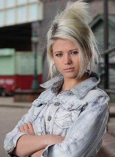 Lola Pearce (Mitchell) played by Danielle Harold