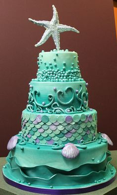 Aquamarine wedding cake with starfish cake topper.
