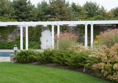 stunning pergola, gate and plantings designed by Conte & Conte, LLC