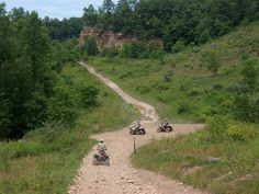 Hatfield and McCoy Trails, West Virginia, could ride ATV's into town, stop for gas and eats.......