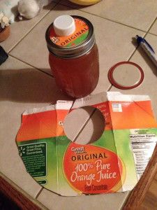 Trim a circle around the spout on an orange juice container to fit the under the screw cap of a mason jar – genius!!! via