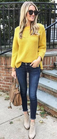 fall outfit idea: yellow sweater + bag + skiknny jeans + boots