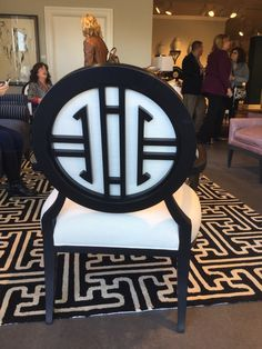 You'll say WOW when  you see the #Olivia #Chair by @tobifairley for @crlaine new this market. Bright Bold and Tailored describes this stylized logo on the back of this occasional chair. A must see! #HPMKTss 2015 Fall